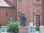Immigrants Statue in front of St. Ambrose Catholic Church on the Hill